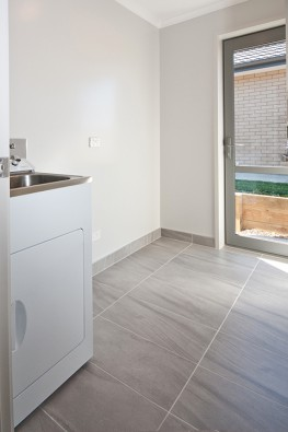 Laundry with tiled floor